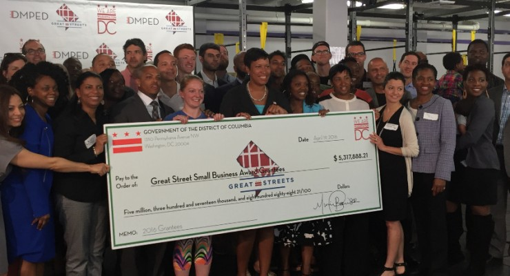 The mayor poses with the Great Streets grant recipients. (photo courtesy of the Deputy Mayor's Office for Planning and Economic Development)